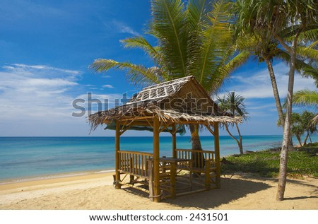 bamboo house on the sandy beach