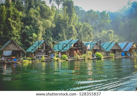 Stock Photo bamboo house Resort in Ratchaprapha Dam at Khao Sok National Park, Surat Thani Province, Thailand.
