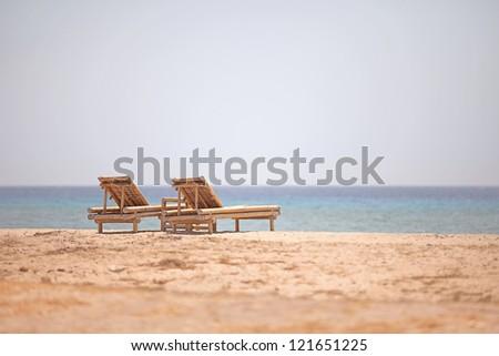 Bamboo loungers on the beach. Gili Island, Indonesia. - stock photo