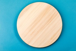 Bamboo or wooden rotating tray, on a blue background