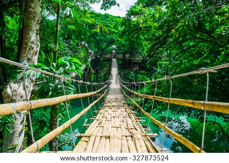stock photo bamboo pedestrian suspension bridge over river in tropical forest philippines 327873524 - Каталог - 3d фотообои
