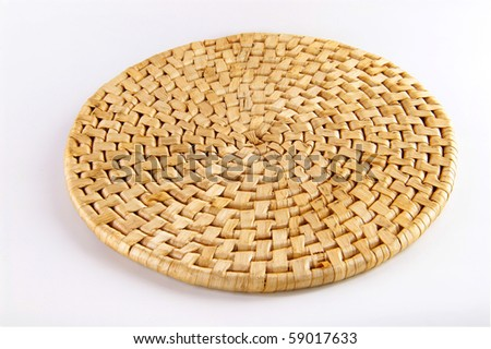 Bamboo place mat isolated on white. Concept of eco friendly household item.