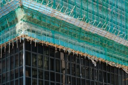 Bamboo pole scaffolding on building construction site -