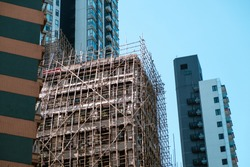 Bamboo pole scaffolding on building construction site
