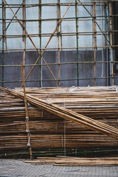Bamboo poles for scaffolding on building construction site -