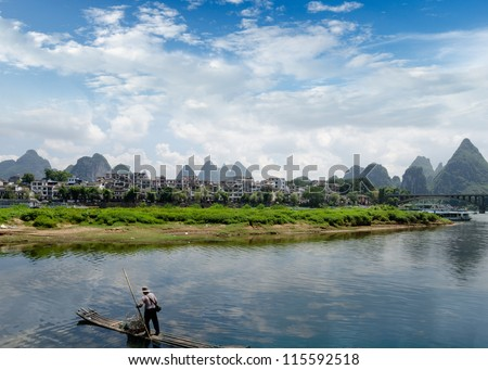 Bamboo raft at the Ulong river near Yangshuo, Guanxi province, China