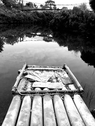Bamboo rafts docked by the river bank(Black and white photo)