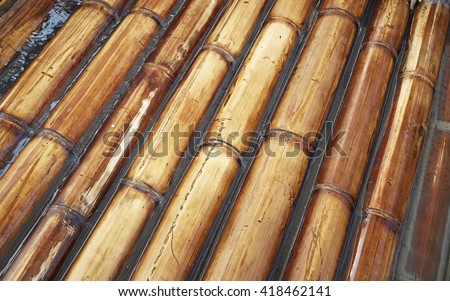 bamboo rafts floating in a lake, water #418462141