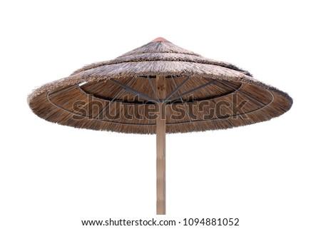 Bamboo, reed, straw beach umbrella isolated on white #1094881052