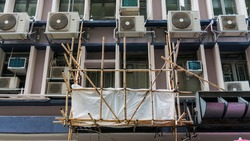 Bamboo Scaffolding Platform On the outside of a Building In Hong Kong