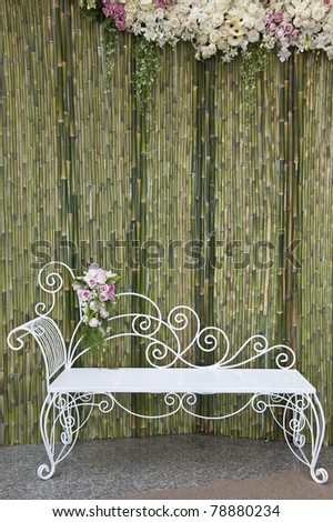 Bamboo wall with white bench