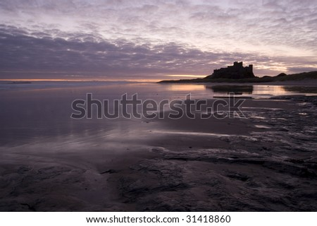 Bamburgh Castle at Northumberland coast at sunrise
