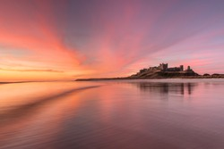 Bamburgh Castle, built on a dolerite outcrop, the location was previously home to a fort of the native Britons known as Din Guarie and may have been the capital of the British kingdom.