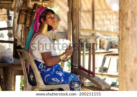 BAN NAI SOI, MAE HONG SON PROVINCE, THAILAND - FEBRUARY 6: Karen tribe woman working at loom in Ban Nai Soi, Thailand, February 6, 2014. Repression Karen in Myanmar forced them to flee to Thailand