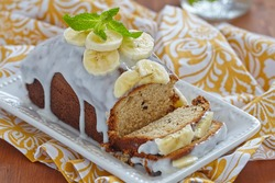 Banana bread with chocolate chips on wooden table