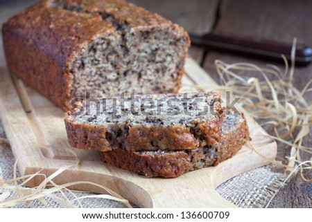 Banana bread with walnuts on the kitchen board