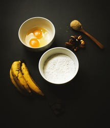 Banana breat ingredients on black background