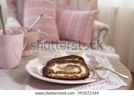 Banana  cake and cup of tea  on  pink vintage background