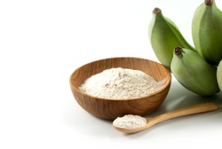 Banana flour and raw green bananas on a white background, prebiotic food for gut health.