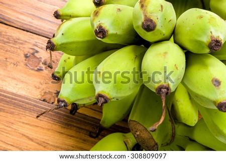 Banana / Green Banana / Banana on Wooden Background