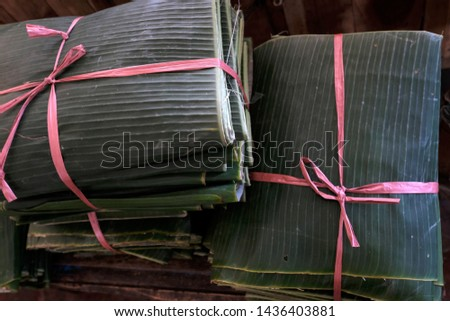 Banana leaves are commonly used in Indonesia as traditional food containers, or as food wrappers in traditional markets. selective focus