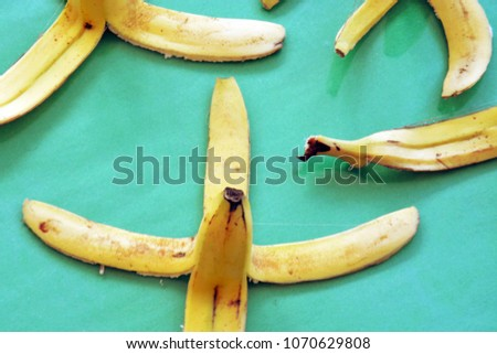 Banana peels in front of colorful background