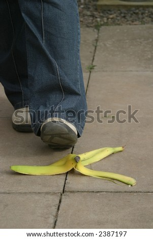 Banana skin on ground with person about to slip