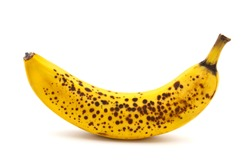 Banana with dark spots with shadow isolated on white background. Closeup, selective focus