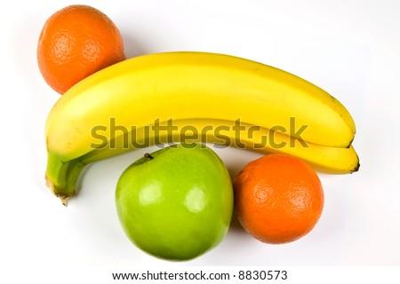 Bananas, tangerines, apple isolated on white