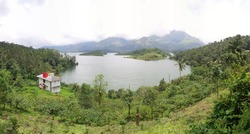 Banasura Sagar Dam, which impounds the Karamanathodu tributary of the Kabini River, is part of the Indian Banasurasagar Project consisting of a dam and a canal project started in 1979.