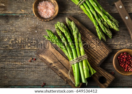banches of fresh green asparagus on wooden background, top view Stock photo ©