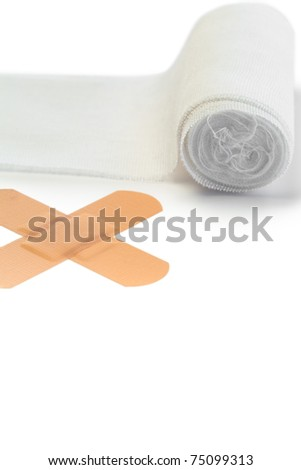 Band-aid and tensor bandage on a white background