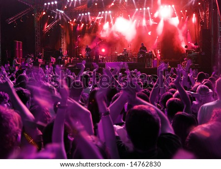 Band at rock music concert. Blur crowd motion - stock photo