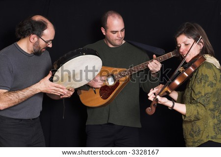 band playing celtic music over black background