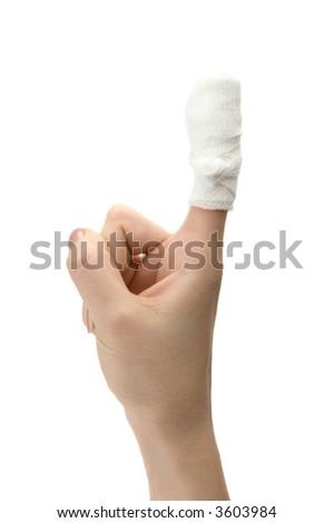 Bandaged finger close up on white background - stock photo