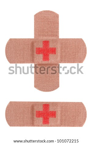 Bandaids or bandages with red cross isolated on white.