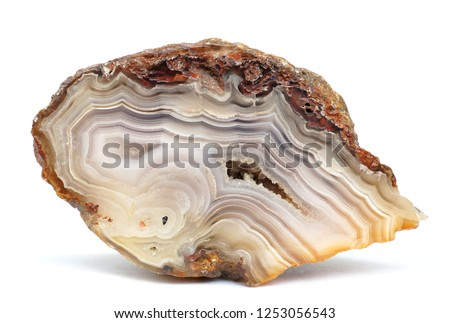 Banded Agate specimen. The layered structure is formed when a rock cavity or geode is filled with siliceous matter, layer by layer. #1253056543