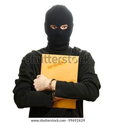 Bandit in black mask in handcuffs with top secret envelope isolated on white