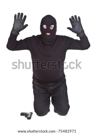 bandit kneeling and surrending on white background - stock photo
