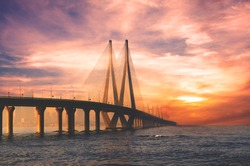 Bandra Worli sea link bridge of Mumbai and golden dramatic sky and cloud