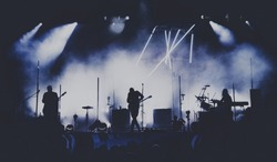 Bands silhouettes on a concert