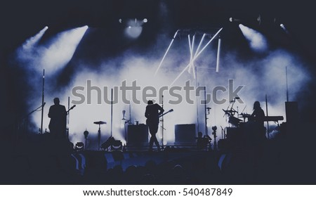 Bands silhouettes on a concert #540487849