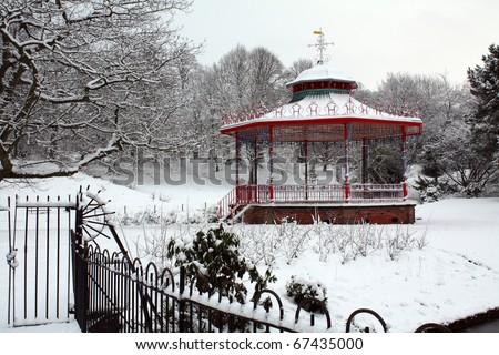 bandstand snow scene sefton park, liverpool, england - stock photo