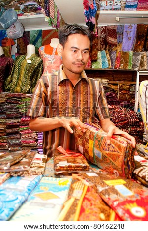 BANDUNG-JUNE 26: Unidentified batik sellers at Pasar Baru Trade Centre prepares for customer on June 26, 2011 in Bandung, Indonesia. In 2009 UNESCO recognized batik as an Indonesian cultural treasure.