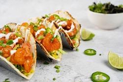 Bang Bang shrimp Tacos on soft taco shell