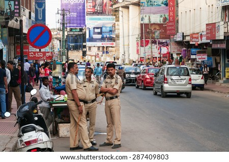 BANGALORE, INDIA - DEC 25, 2014: Policemen on Commercial street. Commercial street in Bangalore is one of the main shopping complexes in India