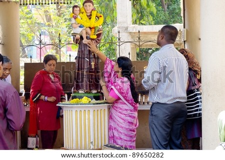 BANGALORE, INDIA - MARCH 22: Christians praying on March 22, 2011, St. Patrick's Church, Bangalore, India. Christianity is the 3rd largest religion in India with 25 million mainly Catholic followers.