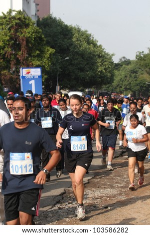 BANGALORE, INDIA - MAY 27: Professional athletes and other participants participate in Tata Consultancy Services World 10K Bangalore Marathon on May 27, 2012 in Bangalore, India.