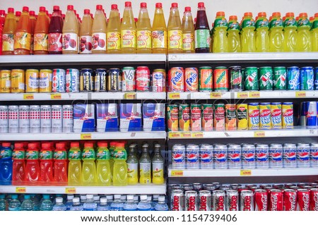 Bangalore, India - 12/03/2006: The drinks shelf / section in a local super market. #1154739406