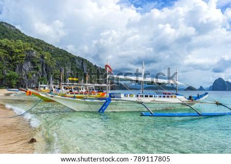 Bangka boats on the beatiful beaach in EL Nido bay, Philippines